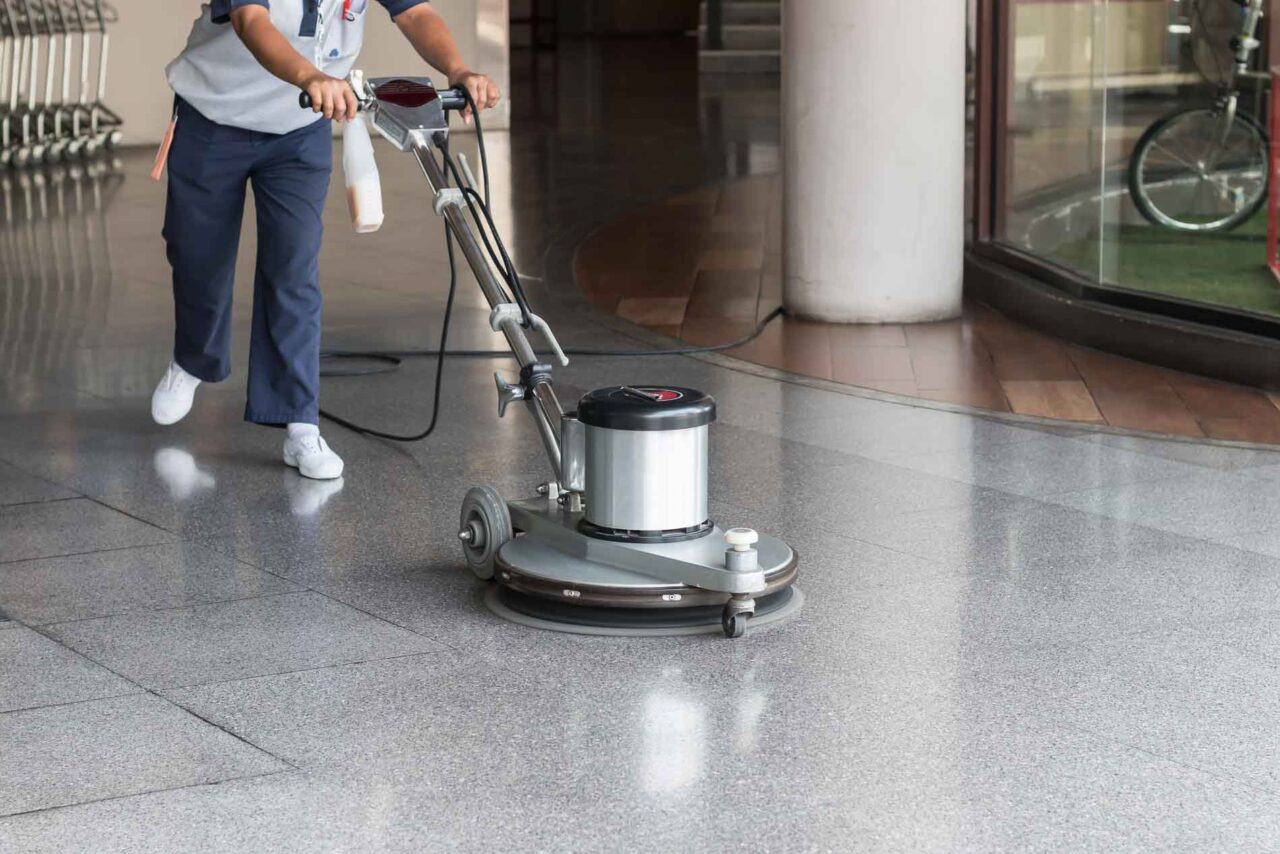Woman,Worker,Cleaning,The,Floor,With,Polishing,Machine